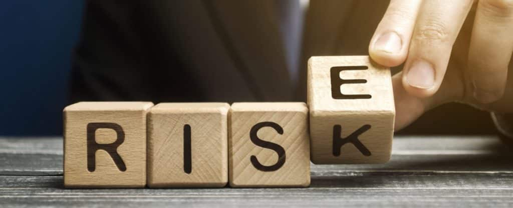 American national insurance company review with picture of wooden blocks spelling risk.