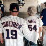 Elderly couple wearing baseball jerseys that combined read