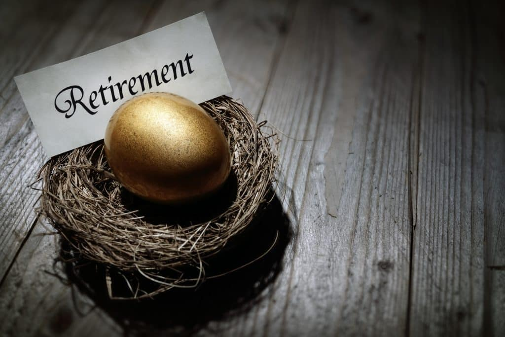 Retirement nest egg picture of bird nest with golden egg in it and a note that says retirement