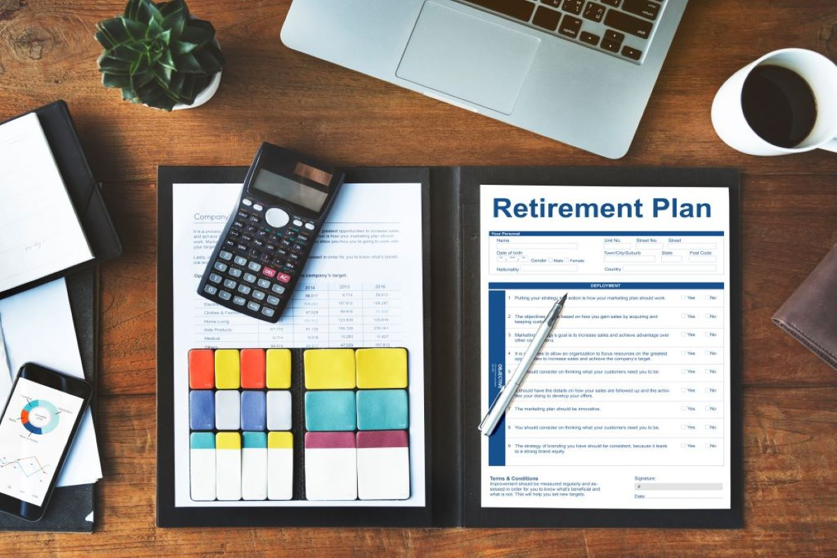 Retirement planner on desk with calculator and chart index annuity crediting methods page