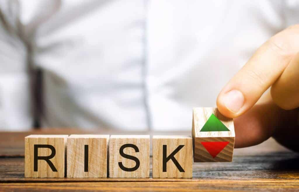 Risk spelled out with wooden blocks COMDEX Score explained article
