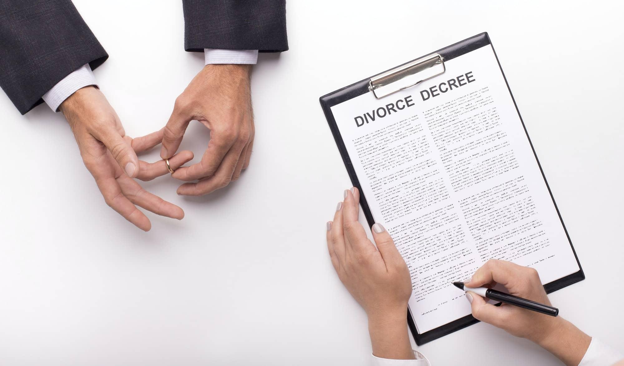 Lawyer draw up divorce decree on planner