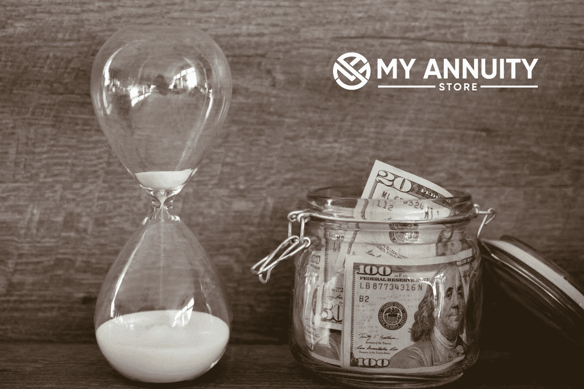 Athene accumax annuity review picture of hourglass with white sand sitting next to glass jar with american cash in it